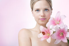 Face of a beautiful woman with lily Stock Photography
