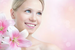 Face of a beautiful woman with lily Stock Photos
