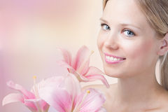 Face of a beautiful woman with lily Royalty Free Stock Images