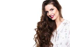 Face of the beautiful woman with long curly hair isolated on white background. Stock Photography