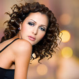 Face of  beautiful woman with long curly hairs Stock Photo