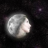 Face of the beautiful woman in the night sky. Royalty Free Stock Photography
