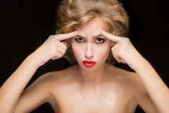 Face of beautiful woman pointing at  her forehead Royalty Free Stock Photos