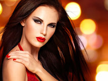 Face of a beautiful woman with red nails and lips Royalty Free Stock Photography
