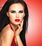Face of a beautiful woman with red nails and lips Royalty Free Stock Image