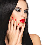 Face of a beautiful woman with red nails and lips Royalty Free Stock Photos