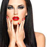 Face of a beautiful woman with red nails and lips Royalty Free Stock Photo