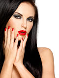 Face of a beautiful woman with red nails and lips Stock Photography