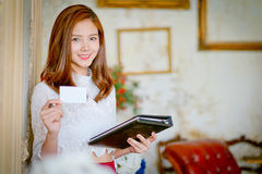 Face of beautiful woman showing blank name card. Royalty Free Stock Photo