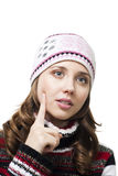 Face of a beautiful woman thinking in winter cap Stock Photo