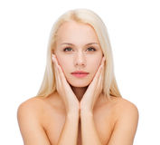 Face of beautiful woman touching her face skin Stock Photography