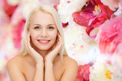 Face of beautiful woman touching her face skin Royalty Free Stock Photo