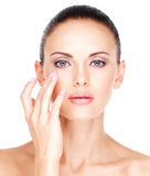 Face of  a beautiful  woman who touching skin near eyes Stock Photo