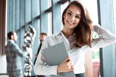 Face of beautiful woman on the background of business people. royalty free stock photo