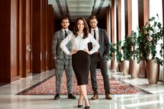 Face of beautiful woman on the background of business people. Stock Photos