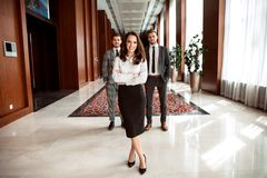 Face of beautiful woman on the background of business people. Stock Photography