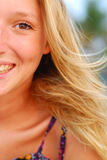 Face of beautiful young blond girl. Tightly cropped face portrait of attractive,smiling young blond girl. Only half of the face is visible Royalty Free Stock Image