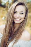 Face of a beautiful young smiling girl - close up. Beautiful girl face - outdoor portrait Stock Photo