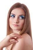 Face of a beautiful young woman with bright blue Royalty Free Stock Photo