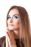 Face of a beautiful young woman with bright blue Stock Photo