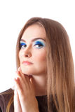 Face of a beautiful young woman with bright blue eyes Stock Image