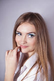 Face of a beautiful young woman with bright blue eyes Stock Photos