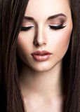 Face of beautiful young woman with brown make-up and  straight Royalty Free Stock Image