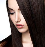 Face of beautiful young woman with brown make-up and  straight Stock Images