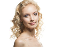 Face of a beautiful young woman curly blond hair stock photography