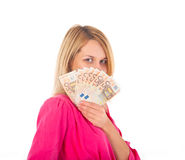 Face of a beautiful young woman and the money- euro Stock Images