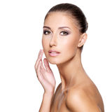 Face of a beautiful young woman with perfect skin Stock Photos