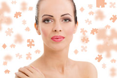 Face of beautiful young woman with a puzzle collage Royalty Free Stock Image