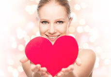Face of a beautiful young woman with red heart Stock Photo