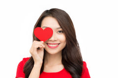 Face of a beautiful young woman with red heart Stock Images