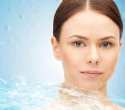 Face of beautiful young woman and water splash Royalty Free Stock Photos