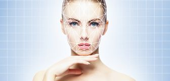 Face of a beautifyl girl with a scnanning grid on her face. Face id, security, facial recognition, authentication royalty free stock images