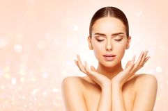 Face Beauty Skin Care, Woman Natural Make Up, Beautiful Model. Closed Eyes Advertising Product in Hands royalty free stock images