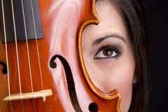Female Face Behind Violin Stringed Instrument Stock Photography