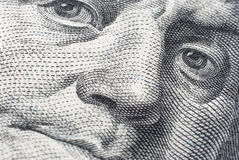 The face of Benjamin Franklin on a hundred-dollar bill Stock Images