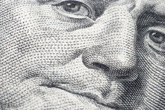 The face of Benjamin Franklin on a hundred-dollar bill Royalty Free Stock Photo
