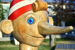 Face of big wooden Pinocchio sculpture in Moscow stock image