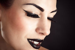 Face with black makeup and long eyelashes Royalty Free Stock Photography
