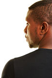 Face of black man in profile view. From behind royalty free stock photo
