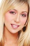 Face of blond girl Stock Photos