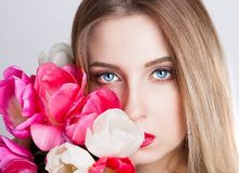 Face, blue eyes, tulips Royalty Free Stock Photos