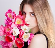 Face, blue eyes, tulips Stock Photo
