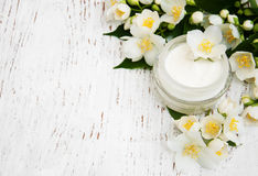 Face and body cream moisturizers with jasmine flowers Stock Image