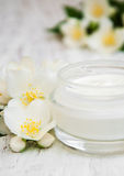 Face and body cream moisturizers with jasmine flowers Royalty Free Stock Image
