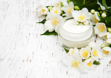 Face and body cream moisturizers with jasmine flowers Royalty Free Stock Images