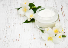 Face and body cream moisturizers with jasmine flowers Stock Photography